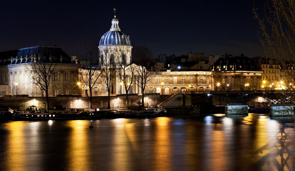 French Academy above river in Paris at night @shutterstock