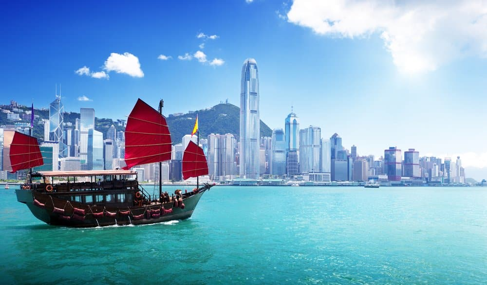 Hong Kong from its best side - View of Victoria Harbour with the iconic ship @shutterstock