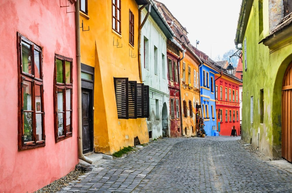 Sighisoara, Romania. Stone paved old streets with colorful houses in Sighisoara fortress, Transylvania region of Europe