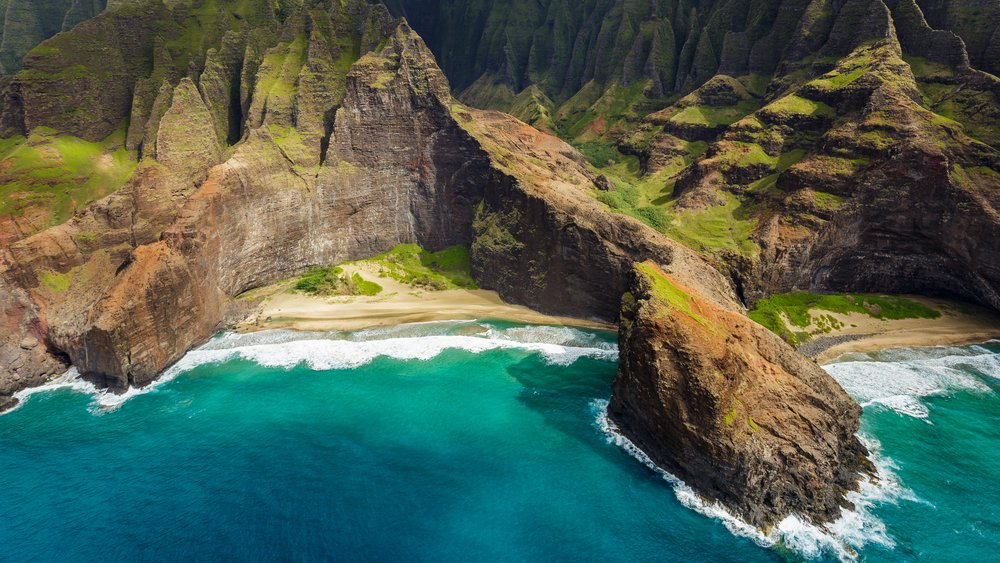 View of the monumental Na Pali Coast at Honopu Valley and Kalepa Ridge, aerial shot from a helicopter, Kauai, Hawaii.