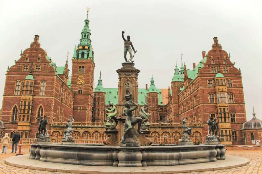 One of the best places to go in Denmark Frederiksborg Castle near Copenhagen Denmark