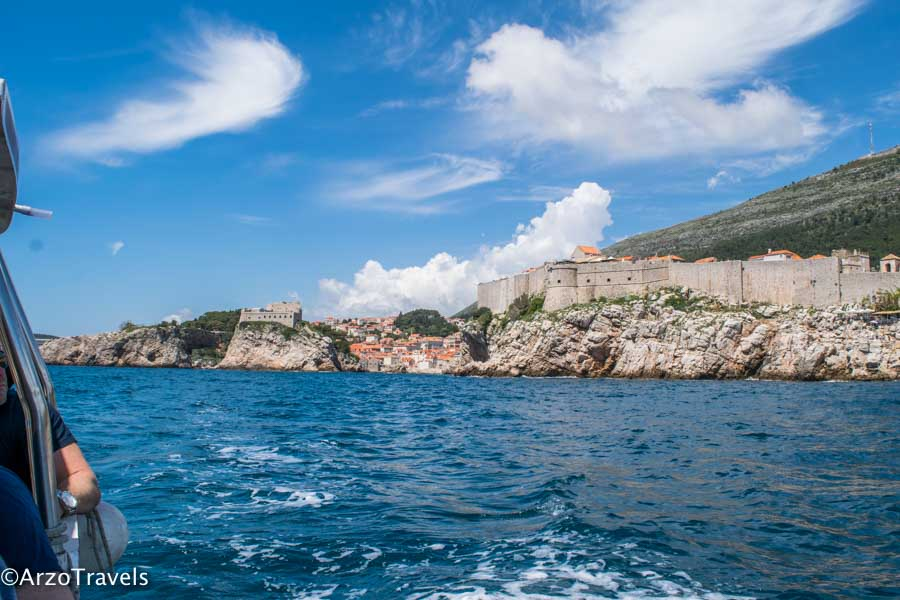 Dubrovnik city walls seen from a boat which is one of the top things to do in two days