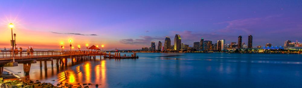 Panorama of Coronado old pier reflecting on in San Diego Bay from Coronado Island, California