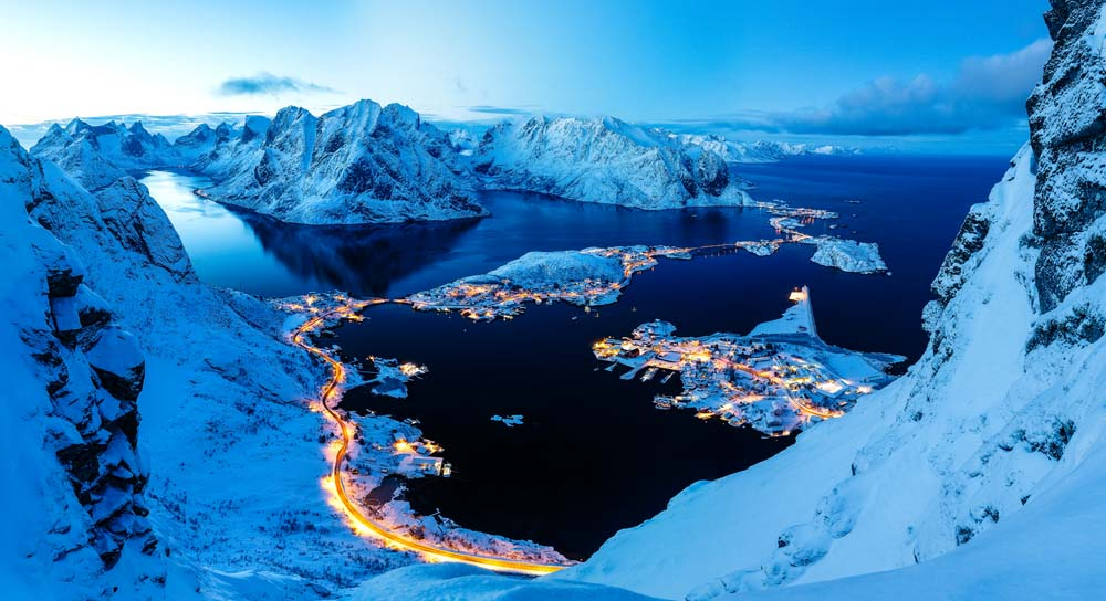 Breathtaking panorama of night surrounded by snowy peaks, Reinebringen Lofoten, Norway