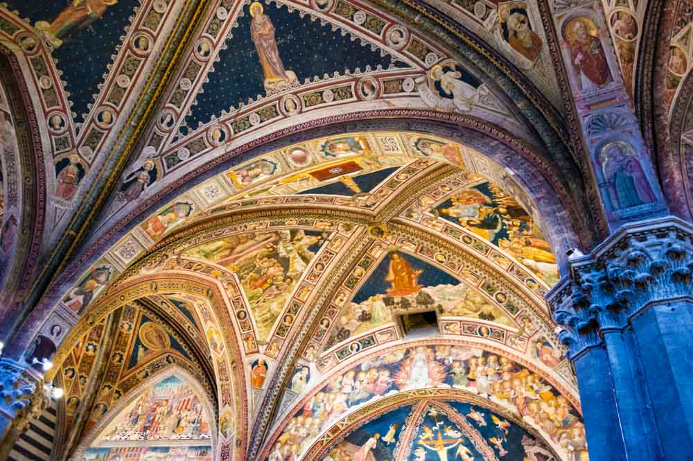 Baptistery of Saint John ceiling interior in Siena Cathedral complex.Hani Santosa, Shutterstock.com