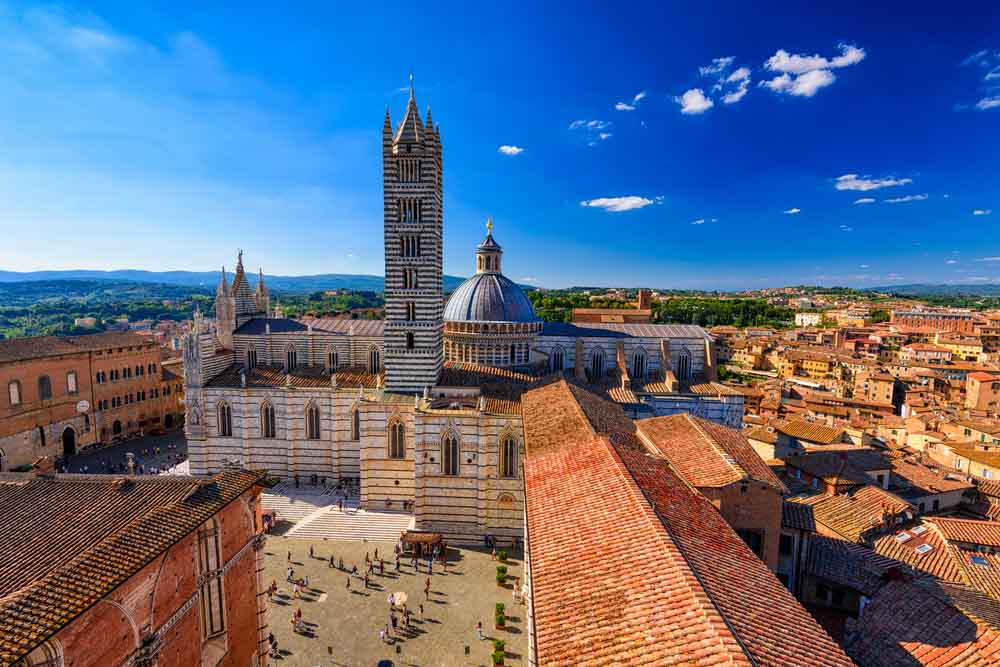 View of Siena Cathedral (Duomo di Siena) and Piazza del Duomo in Siena. Siena, UNESCO a World Heritage Site