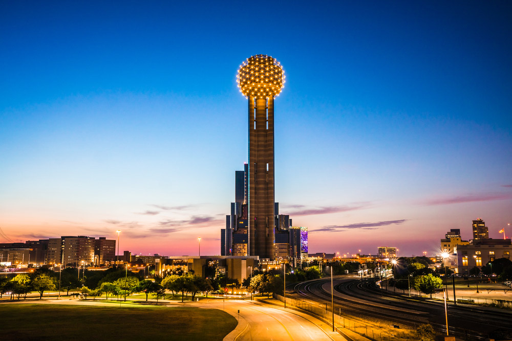 The Reunion Tower stands as the sun sets in Dallas, Texas. stock_photo_world, Shutterstock.com
