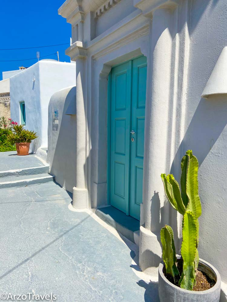 Doors and flowers in Pyrgos in Santorini, Greece with Arzo Travels