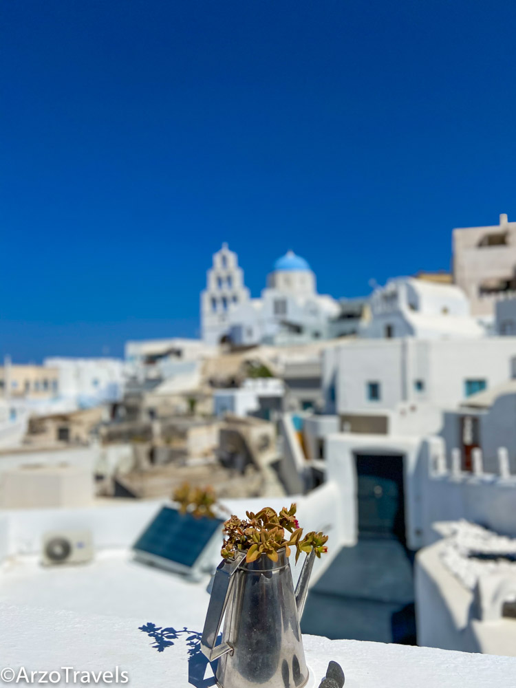 View with a drink Pyrgos in Santorini, Greece with Arzo Travels